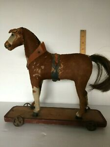 Antique German Platform hide covered horse pull toy very primitive