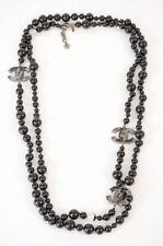 Chanel black enamel CC globe interlocking logo long pearl strand necklace $1525