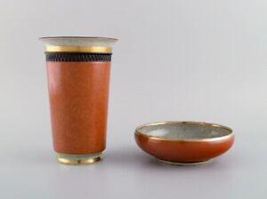 Royal Copenhagen. Bowl and vase in crackle porcelain, in gold and orange.