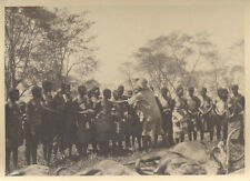 1920S PHOTO OF TRADITIONAL TRIBES PEOPLE W/ DEAD WILDEBEESTS - MOZAMBIQUE
