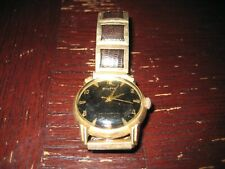 vintage bulova gold and leather
