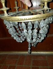 antique brass light fixture with crystals