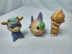 Vintage Kewpie Squeaky Doll cow squeaky and fish toy with bell inside