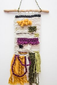 Obstract handwoven wall hanging.Boho weaving interior decoration