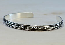 sterling cuff patterned with flowers