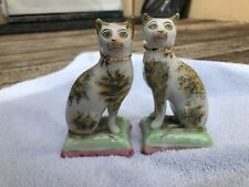 pair of Staffordshire china cats