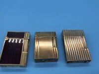 3 Dupont Feuerzeuge Laque De Chine und 2x vergoldete als Ersatzteilspender.