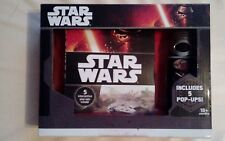 Star wars book and 5 sounds flashlight. Includes 5 pop ups New and sealed.