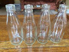 Four Glass Milk Bottles