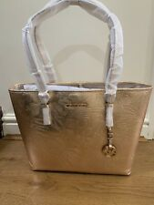 81d1591f364a MICHAEL KORS MK LARGE JET SET TRAVEL BAG IN PALE GOLD PALM EMBOSSED LEATHER