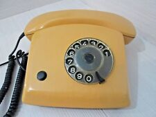 Telephone rotary disk yellow with button. 1984 phone