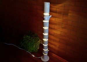 Wooden floor lamp is made of natural logs, floor fixtures, driftwood
