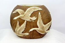 PHOENIX SCULPTED ART GLASS PILLOW VASE IN BROWN STAIN WITH IRIDIZED FLYING GEESE