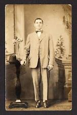 1904-1918 RPPC J H SINCASTER*651 BANK ST*WATERBURY CONNECTICUT*CT*MAN IN BOW TIE