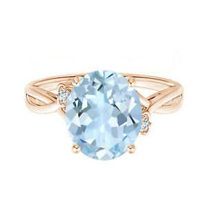 Aquamarine Crossover Ring with Simulated Diamonds In 9k Rose Gold