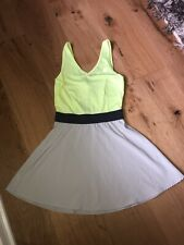 Women's Reebok Tennis dress size small gray and yellow.  Excellent!
