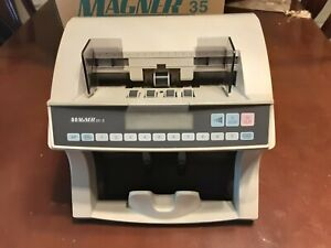 Magner 75 Ud Series banknote counter.