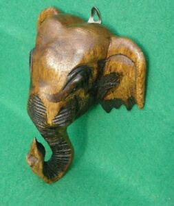 Wallhanging carved Elephant head with pyrography detail  in mid brown hardwood