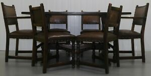 REFECTORY OAK DINING TABLE WITH TWO CARVERS & FOUR DINING STUDDED CHAIRS