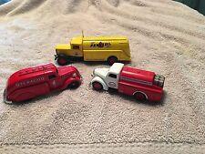 Set of three oil company die cast trucks