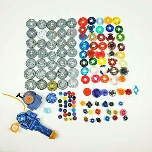 Hasbro Beyblades Huge Mixed Lot 125+ Pieces Launchers Rip Cord Wrench