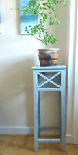 Tall wooden plant table with rustic white/mint finish.