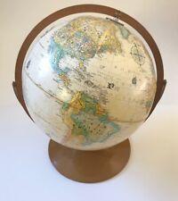 Globemaster 12 Inch Diameter Rotating Globe Raised Textured Surface Brass Base