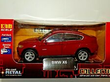 BMW X6 BY WELLY @ 1/38th SCALE WITH  OPENING DOORS AND PULL BACK ACTION IN BOX