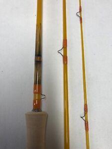 Custom Built 3pc 6'-2wt fiberglass fly rod with feather inlays.