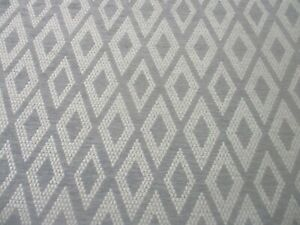 BARGAIN ROLL END 4.6 METRES GREY WOVEN GEOMETRIC UPHOLSTERY FABRIC FR TREATED.