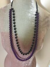 Long double strand black and purple plastic bead necklace ribbon fastening