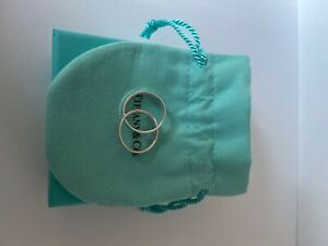 womens size four interlocking tiffany and Co ring