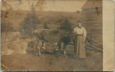 """Antique RPPC Postcard  WOMAN """"HOLDING THE COW TO BE MILKED""""  FARM SCENE"""