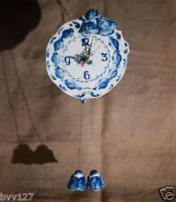 Porcelain wall clock Gzhel blue arabic bellflower