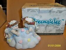 "Dreamsicle Figurine, ""A Kiss In Time"" 1995"