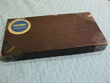 SCRABBLE PARTS box, board has worn corners / 4 wood holders /handfull of letters