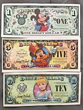 Disney dollars lot of one five and ten. Uncirculated.