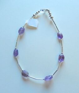 Anklet -silver color-purple oval shaped beads- 11 inches long--