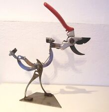 Jesus Flores recycled metal  tools &  bicycle sculpture  bird robot steampunk
