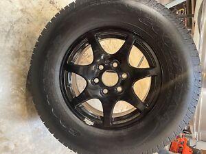 spare tire from 2018 1500 GMC black rim 65/70