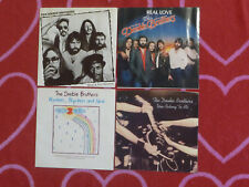 Lot of 4 DOOBIE BROTHERS 45 rpm PICTURE SLEEVES What A Fool Believes/Real Love