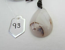 A BEAUTIFUL SMALL PICTURE AGATE PENDANT ON A WAXED CORD NECKLACE. (93)