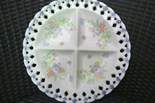 Intricately painted made-in-Japan plate with flower motives
