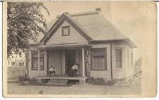 Boy Kid & Mom Woman Front Porch Rocking Chairs 1900s Real Photo Postcard Church