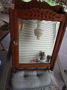 antique quarter sawn oak medicine cabinet with spoon carving & towel rack