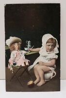 C 1907 Cute Little Girl Bisque Dolls with her Chamber Pot and Tea with Dollie