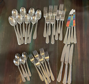 Lot of 33 Oneida Icarus Stainless Steel Flatware Oval Spoons forks knives.