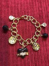Guess Gold Tone Black Heart Charm Bracelet Leopard Stone