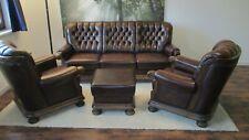 2 Sessel aus braunem Büffelleder