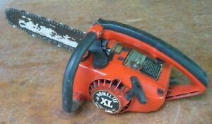 older Homelite XL chainsaw, 12 in. bar
